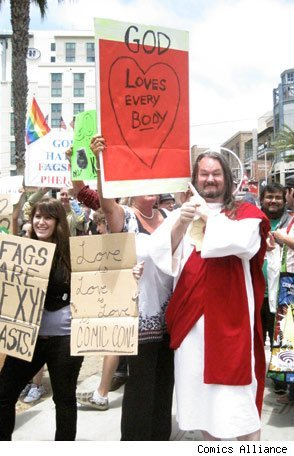 Here I am holding up my righteous sign alongside GOD at Comic-Con.