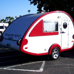 "I spotted this cute little teardrop trailer  in the parking lot of the Yum Yum Donut shop on Jamacha Road. I think ""Da Island Boyz Hawaii"" is either a musical group or a mobile DJ. Does anyone know?"