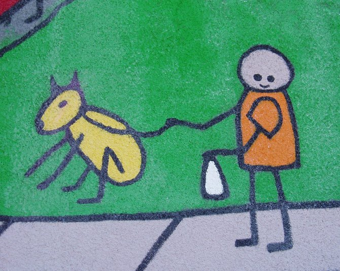 """This is the best section of a mural on the front wall of Balboa Elementary School in Shelltown. The mural is devoted to conservation. It reminds the kids and passers by to """"think blue"""" and to """"do your part"""" to keep the community clean."""