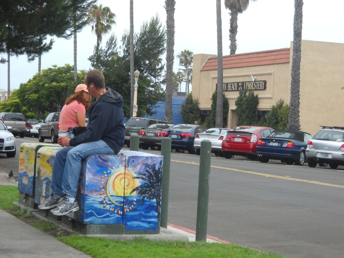 could be termed a desecration by sitting on these beautiful utility box creations.