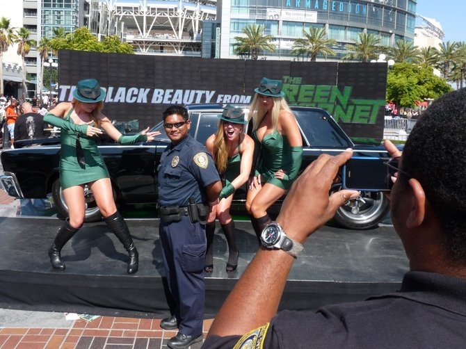 "July 25, 2010 This was on the last day of Comic Con. A police officer taking another officer's photo being ""arrested"" by the Green Goblin Girls."