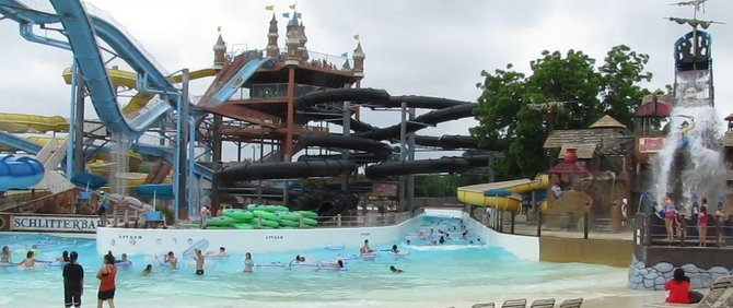 Schlitterbahn's Water Park in New Braunfels, Texas Swooshing through the dark tube on a ribbon of water, we slam from side to side along the snakelike trajectory hurtling ever faster as we careen downward. The inflatable tube cushions our side to side lurches; the tunnel darkness keeps us disoriented and ignorant of the next turn. Through the dragon's mouth we plunge and then - daylight. Whew! What a ride!