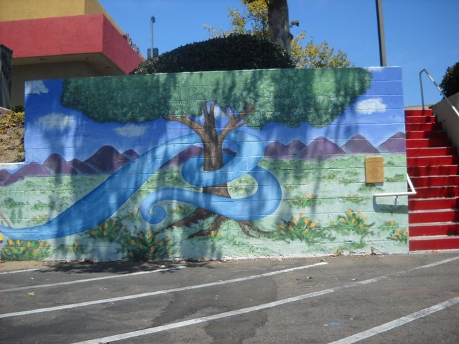 """Our River"" mural alongside Carl's Jr. driveway on Mission Center Road."