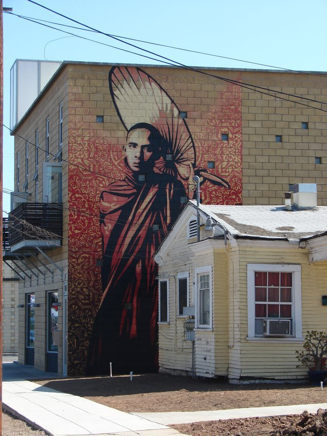 Shepard Fairey's mural on the back of the building at 30th and Ivy in south Park.