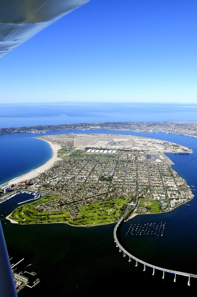 About 3300 feet above downtown on a clear day. Coronado Island and North Island Naval Air Station, the birthplace of Naval Aviation.