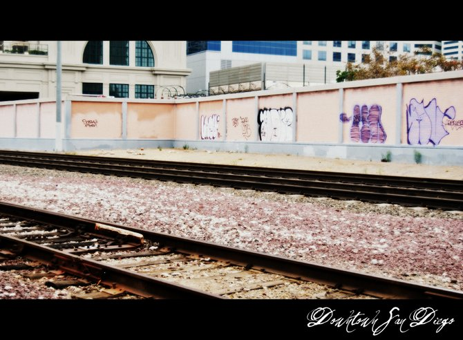 Photo was taken of the train tracks downtown San Diego near Harbor Drive.