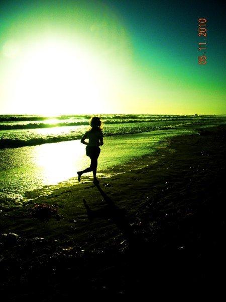 Jogger on Carlsbad beach.