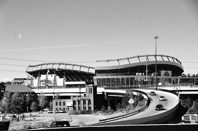 I discovered this in a recent trip to Colorado.   The Broncos field in Colorado has a dramatic undulation and a gap spanning about one quarter of the sitting area. Combined with a freeway ramp, you get a jagged play of curves that is very fun to look at.