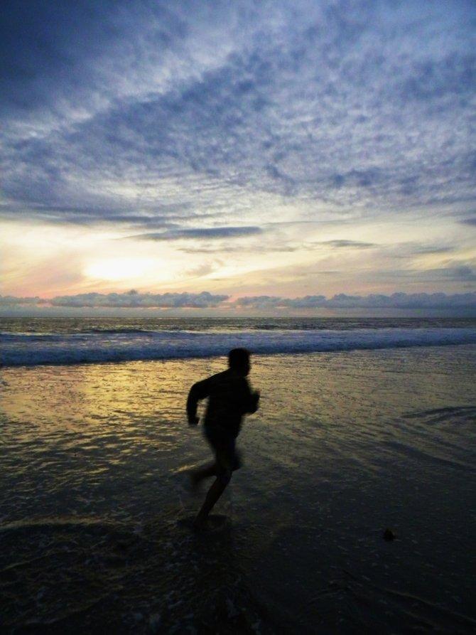 Running at Carlsbad Village beach.