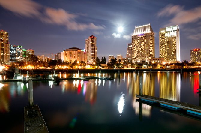 This picture was taken on 10/22/2010. It is the full moon rising over Seaport Village as seen from the docks of the Tuna Fleet.