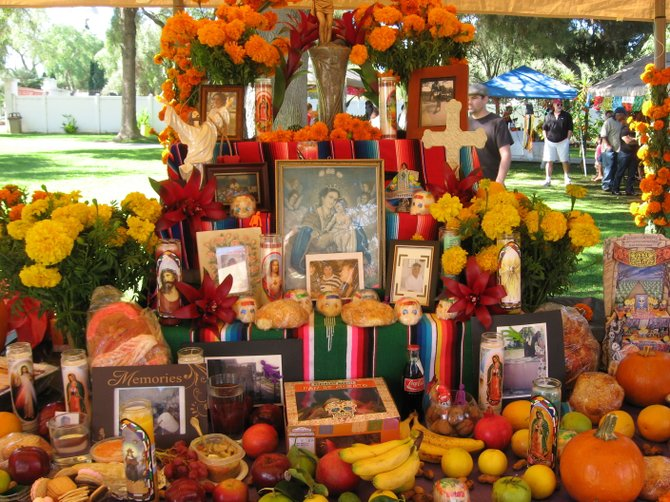 An altar created to honor loved ones who have passed on is on display at the Day of the Dead Festival on October 31, 2010.  Altars are decorated with photos, favorite foods of the deceased person (s),