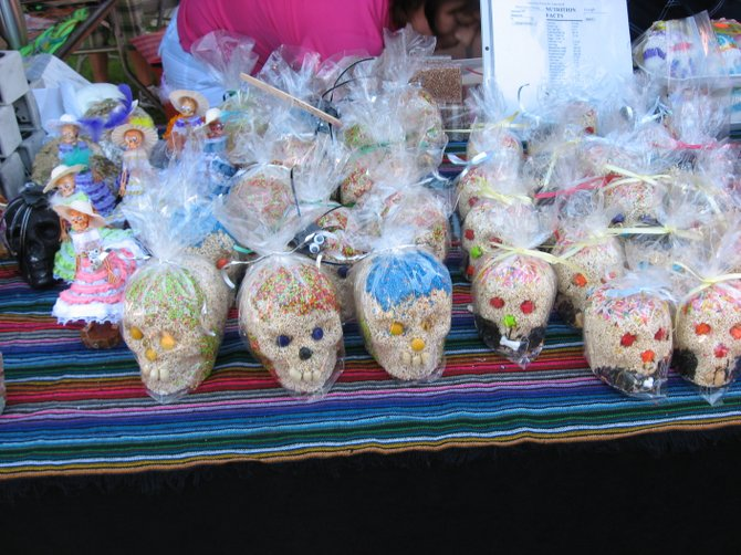 Candy skulls (made out of sesame seeds, I think) being sold by a vendor at the Day of the Dead festival at the Mission San Luis Rey on Sunday, October 31.