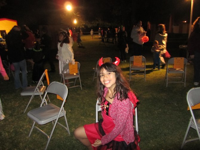 My daughter Elena hoping to win the cake walk at a Halloween carnival.