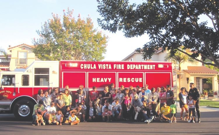 McCain Valley Court residents gather around a Chula Vista fire truck for a block party photo.