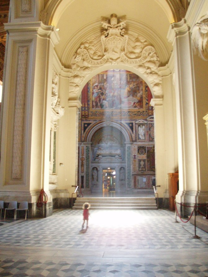 A child runs down an aisle of the basilica of San Giovanni in Laterano in Rome.