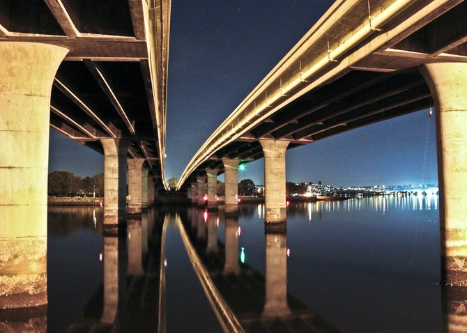 On a crisp clear night the Ingraham bridge creates a stunning reflection off Mission Bay