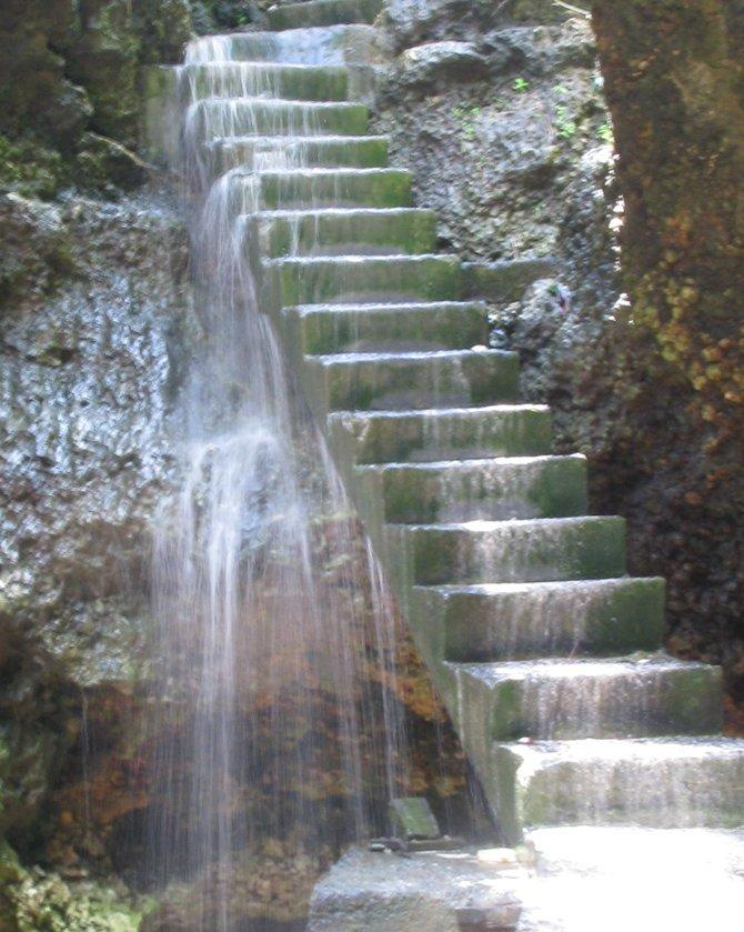 Waterfall staircase in the cave, Uluwatu, Bali