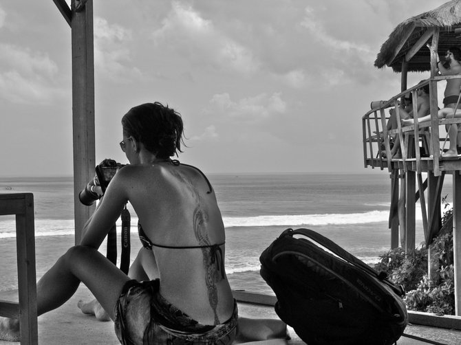 Photo journalist doing her job in Bali style.