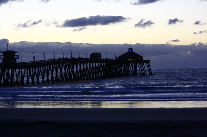Imperial Beach Pier at sunset as a small storm moves in.