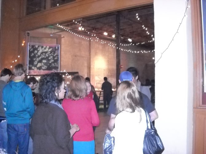 Crowd in line at Culy Warehouse on 12/04 for Advent concert with future of Forestry.