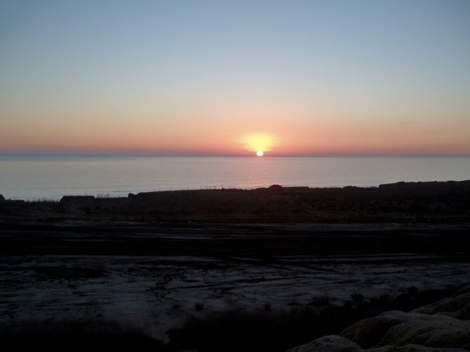 This sunset was caught while driving home from Los Angeles at the lookout point off the I-5 on  Camp Pendleton.