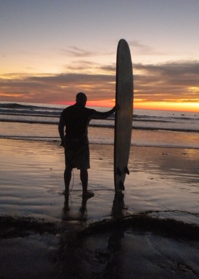 High surf and a long board. End of the day. Thanks.