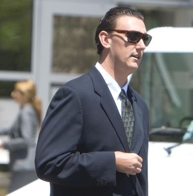 Tyler Mackin leaves courthouse after guilty plea.