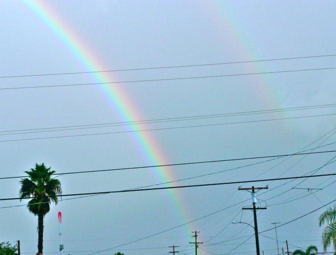 A Double rainbow follows the Storm Train Eastward