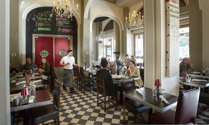 Currant's dining room is a mashup of brasserie, chic bistro, and fancier restaurant.
