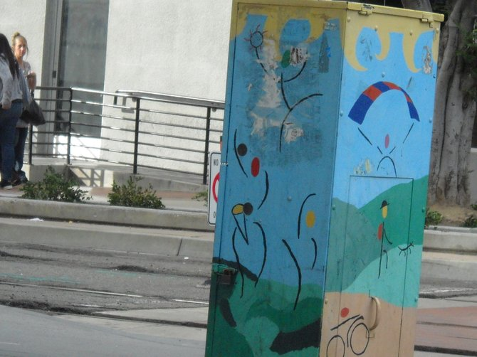 Utility box art along C Street and trolley tracks downtown.