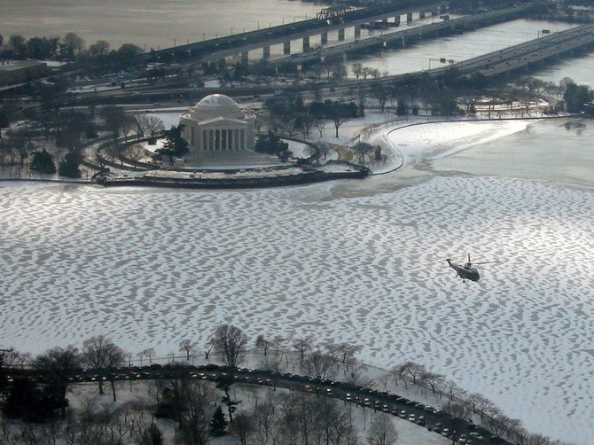Jefferson Memorial and Marine One, on its way to the White House to pick up President Obama for the memorial service in Tuscon, AZ.  Picture taken from atop the Washington Monument,  January 12, 2011.
