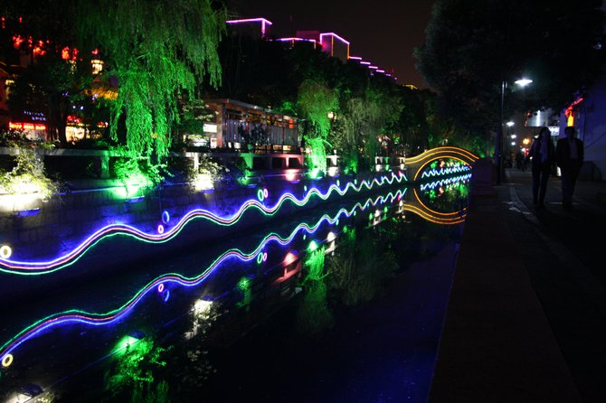 Nighttime view of the neon-lit canal along Lindun Road, Suzhou.