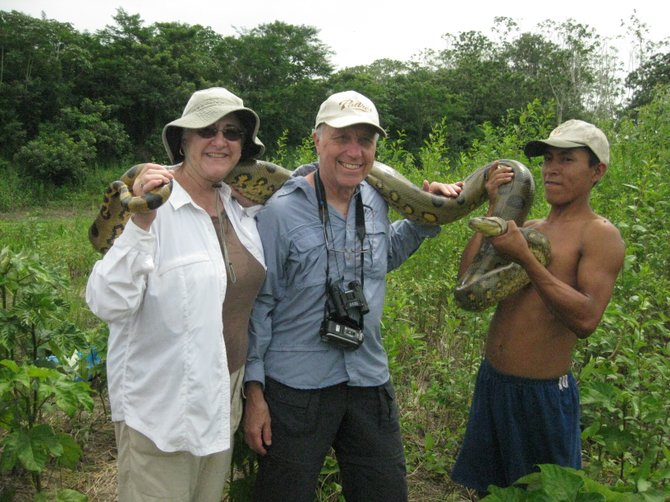 While hiking into village with friends on our Amazon River cruise we discovered this native and asked if he would allow us to take a picture with his Anaconda.  He said yes!