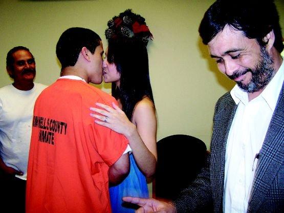 Killer wedding: Convicted murderer Justin Lopez kisses his bride, Mariah Mierya Cavazos, in a jailhouse lobby.