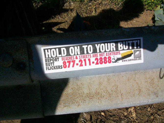 Bumper sticker in alley near OB Pier.