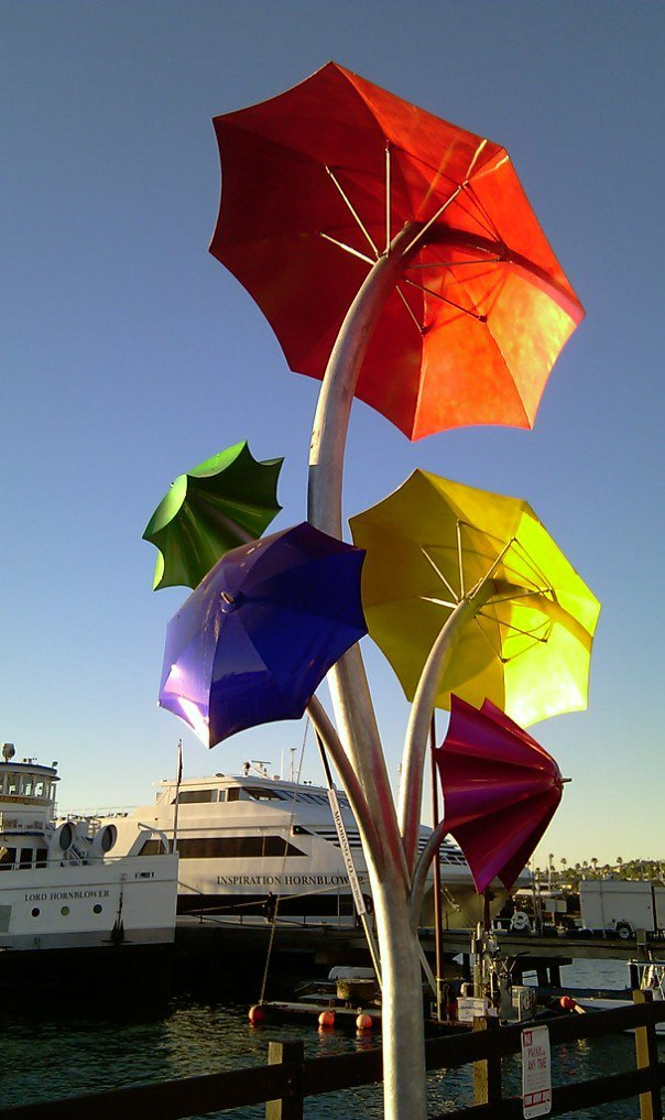 Colors of the sun reflecting from San Diego figure in Sea Port downtown waterfront - Feb 12, 2011.