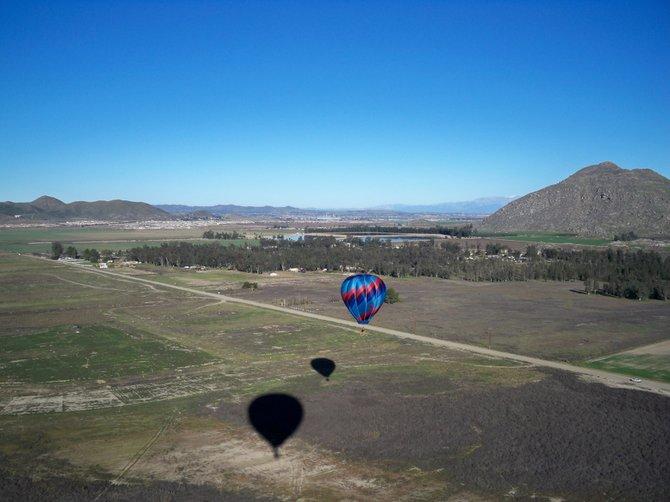 2 hot air balloon cast their shadows near Winchester on this sunrise flight