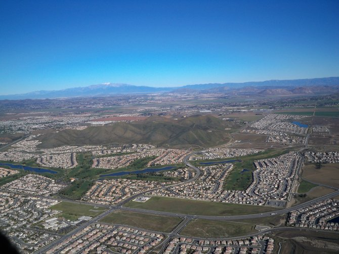 Menifee on the near side of the hill and Sun City on the far side of the hill.  The San Bernardino mountains are in the distance