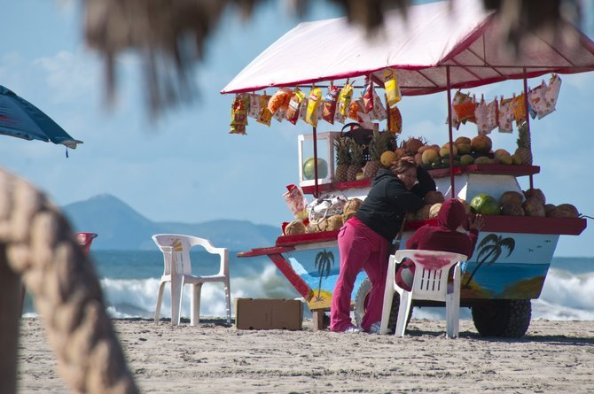 This fruit vendor in a small Baja Beach braves the last few day of the off-season.