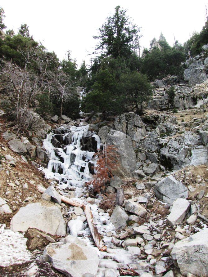 This photo was taken in Big Bear California. The waterfall was frozen for the most part but had  some trickling water still flowing down. I had never before seen a frozen waterfall and what a sight.