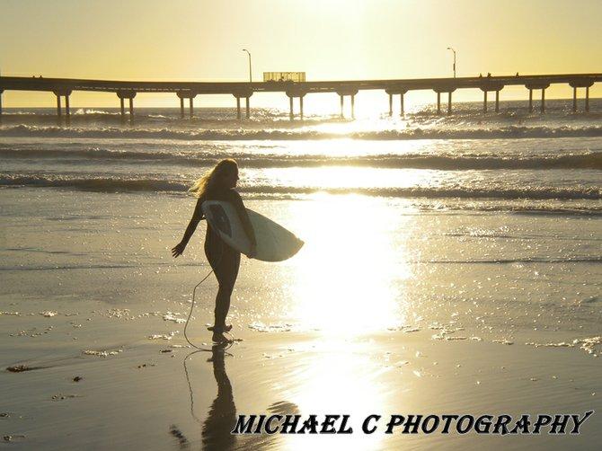 ...local surfer girl at sunset...Ocean Beach..
