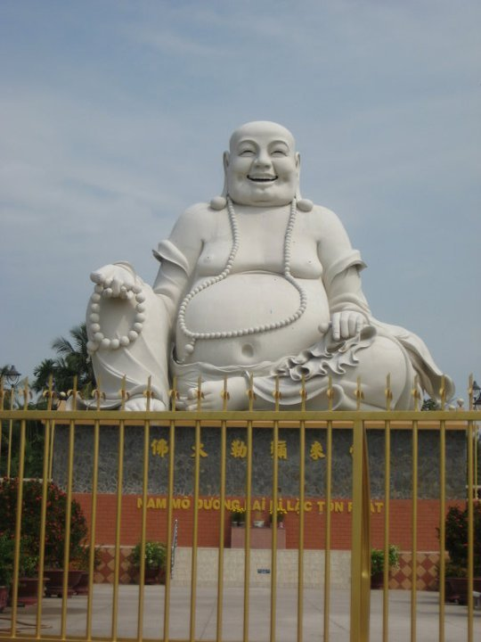Buddah in front of the Buddhist temple in Vietnam.