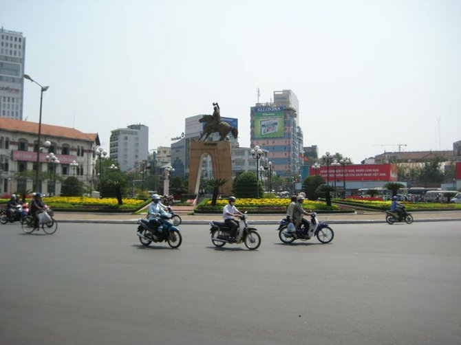 Streets in Vietnam.  Workers getting around in motorcycles.