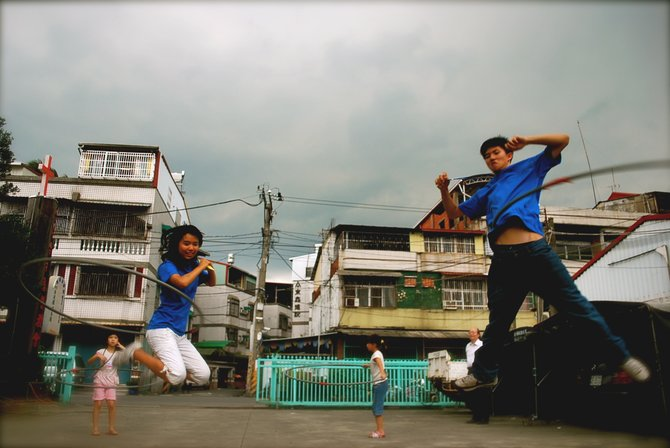 A couple of leaders play during break time at an English summer camp in Ping Tung, Taiwan.