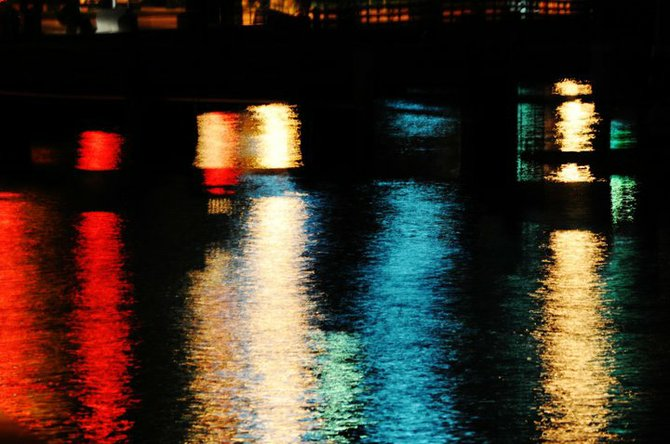 Lights on the water Downtown at sun down.