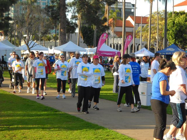 Runners and volunteers getting ready for the Finish Chelsea's Run in Balboa Park.