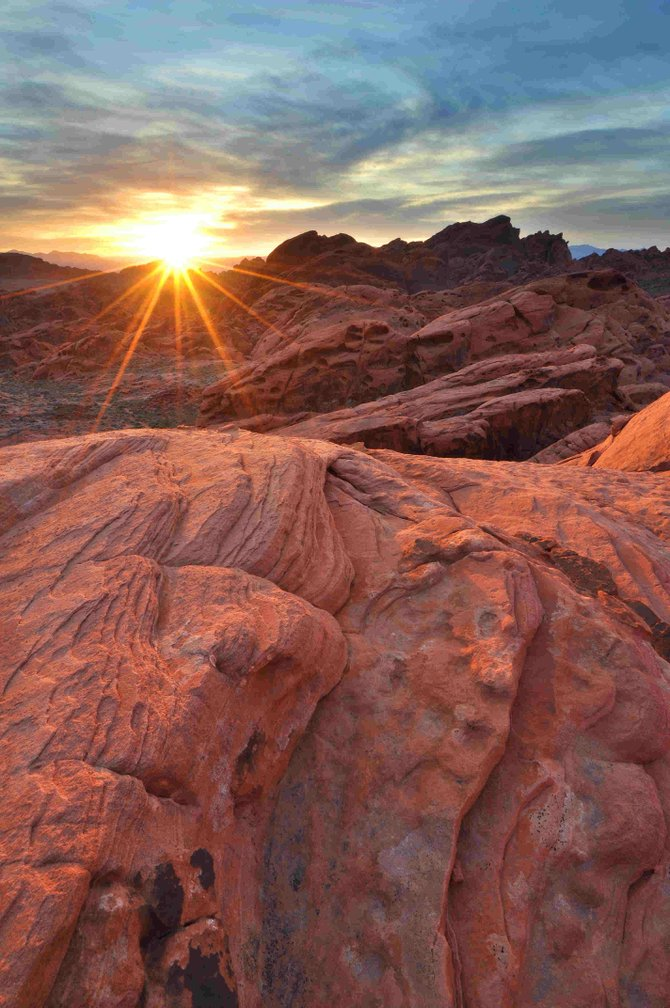This sunrise Photograph was taken atop a sandstone mountain during a hike in Valley of Fire State Park on March 16th, 2011.