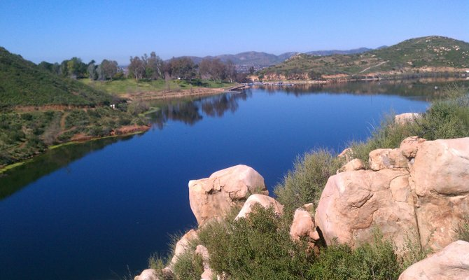 Lake Poway. Climb up rocks to take picture with cell phone.