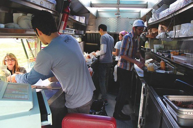 Chef Juan Mirón takes orders inside MIHO Gastrotruck.