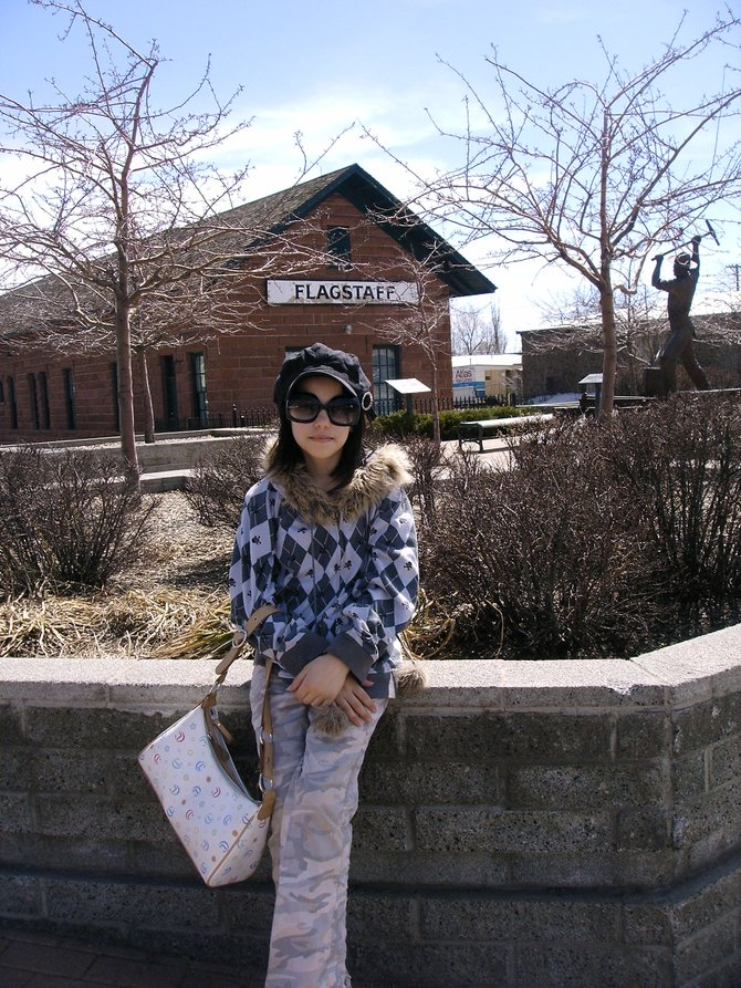 This is a picture of my daughter in front of the train station in Flag. She is such a fashion Diva and as i love documenting, so here is one of many photos snapped of her that day!